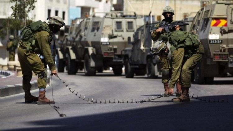 الإحتلال ومستوطنون يشنون حملة عدائية على بلدة فلسطينية